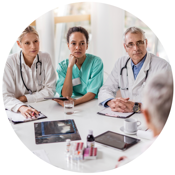 Group-of-Doctors-Having-a-Meeting-in-the-Hospital_iStock-ID-000078795059